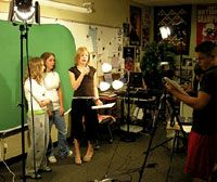 """South Valley Junior High School students in Liberty, Missouri, become journalists to study the Boston Massacre. Rebecca Dillon (with microphone) interviews """"eyewitnesses"""" Breanna Ormsby (left) and Brittany Ruechert."""