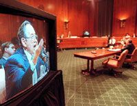 Future Talk: Alvin Toffler appears on a television monitor as he testifies before a congressional committee in June on Capitol Hill. This is the first time interactive video and teleconferencing technology has been used during congressional hearings.