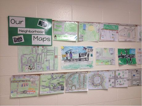 Bulletin boards at Riley School show activities students have done around the Out of Eden Walk.