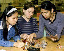 Future Tinkerers: Hiram Johnson High School students Tran Vo (from left), Sylvia Caus, and Shalveena Dayal build a model solar-powered fuel cell car.