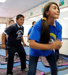 Energy Boost:  Fifth-grade students at Los Angeles's Marvin Avenue Elementary School exercise by playing Dance Dance Revolution.