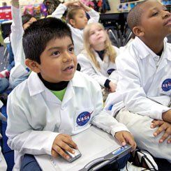 All Aboard: 	 		Third graders in the school's NASA program use wireless tablets to coordinate with their teacher's interactive whiteboard. Similar tools enable students to work on activities, take notes, and launch software applications.