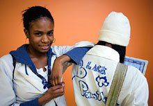 Personal Touch: Autumn Stevens and a fellow student show how they personalize their lab coat uniforms.