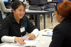 Taxation with Representation:  Junior Nancy Wu, a certified volunteer income tax assistant, helps her client, Danielle Tompkins, file this year's tax return.