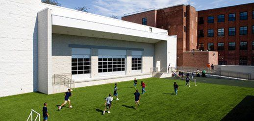 Field of Dreams:  The one entirely new structure at St. Philip's Academy is the full-size gymnasium, separate in style and material.