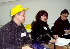 Hat Trick:  Alexander Pojarliev, a professor at the New Bulgaria University, models a technique for demonstrating multiple viewpoints in which discussion participants take various critical roles depending on hat color.