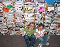 Paper Cutters:  Park School students take a break from stacking unwanted catalogs they have canceled.