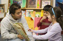 Trickle-Down Theory: JEB Stuart junior Tony Truong is one of many volunteers who read to kindergartners at nearby Bailey's Elementary School.