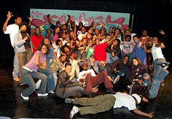 They're a Hit:  Students (ages 5-25) in AWOL's hip-hop history production celebrate a sold-out performance with a group photo.