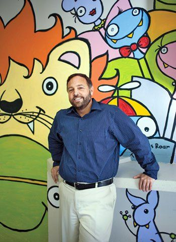 Standing Out: Bob Parlin, pausing in front of a mural painted by his partner, Bren Bataclan, embodies self-confidence.