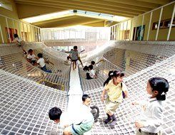 Kid Stuff: Such elements as the big net in the commons area at the Yuyu-no-mori Nursery School and Day Nursery encourage large-muscle activity and kinesthetic stimulation.