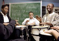 In the Rhythm: Ebony Mauney (from left) and Travis Nieves try to keep up with teacher Harold Akyiampong.