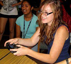 Game On:  Alexi Ramsey plays Mortal Kombat on Game Day at the IT Girl Summer Academy.