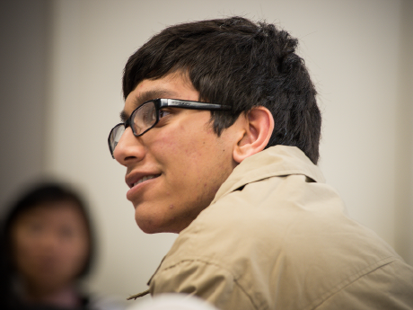 Photo of a young man listening attentively