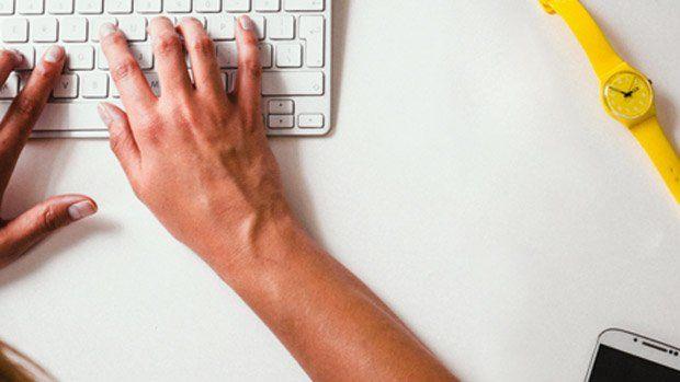 Photo of hands at keyboard