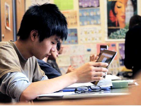 Boy in class using a tablet