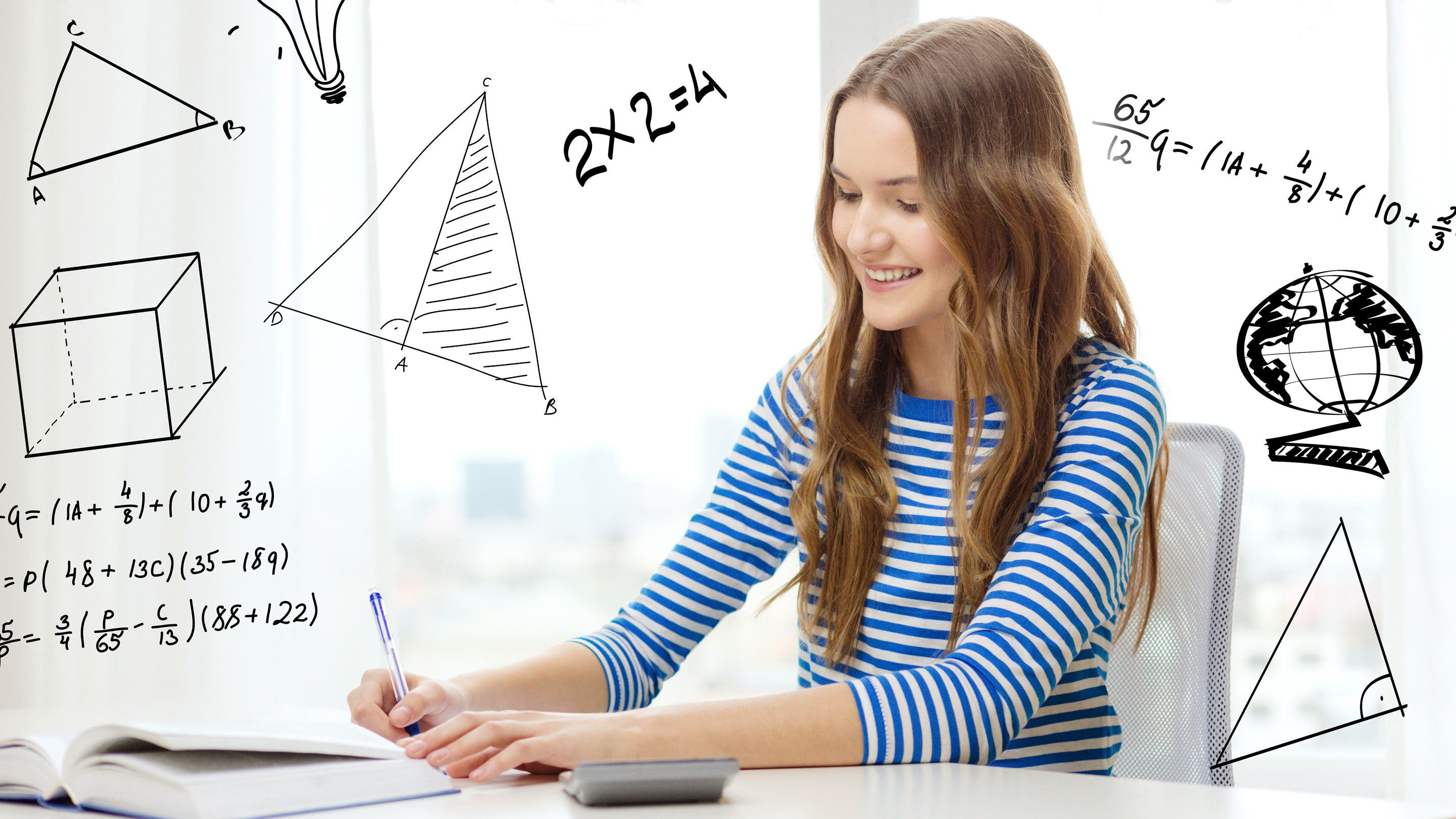 Photo of a student working on her math assignment, with diagrams and formulas written on the photo