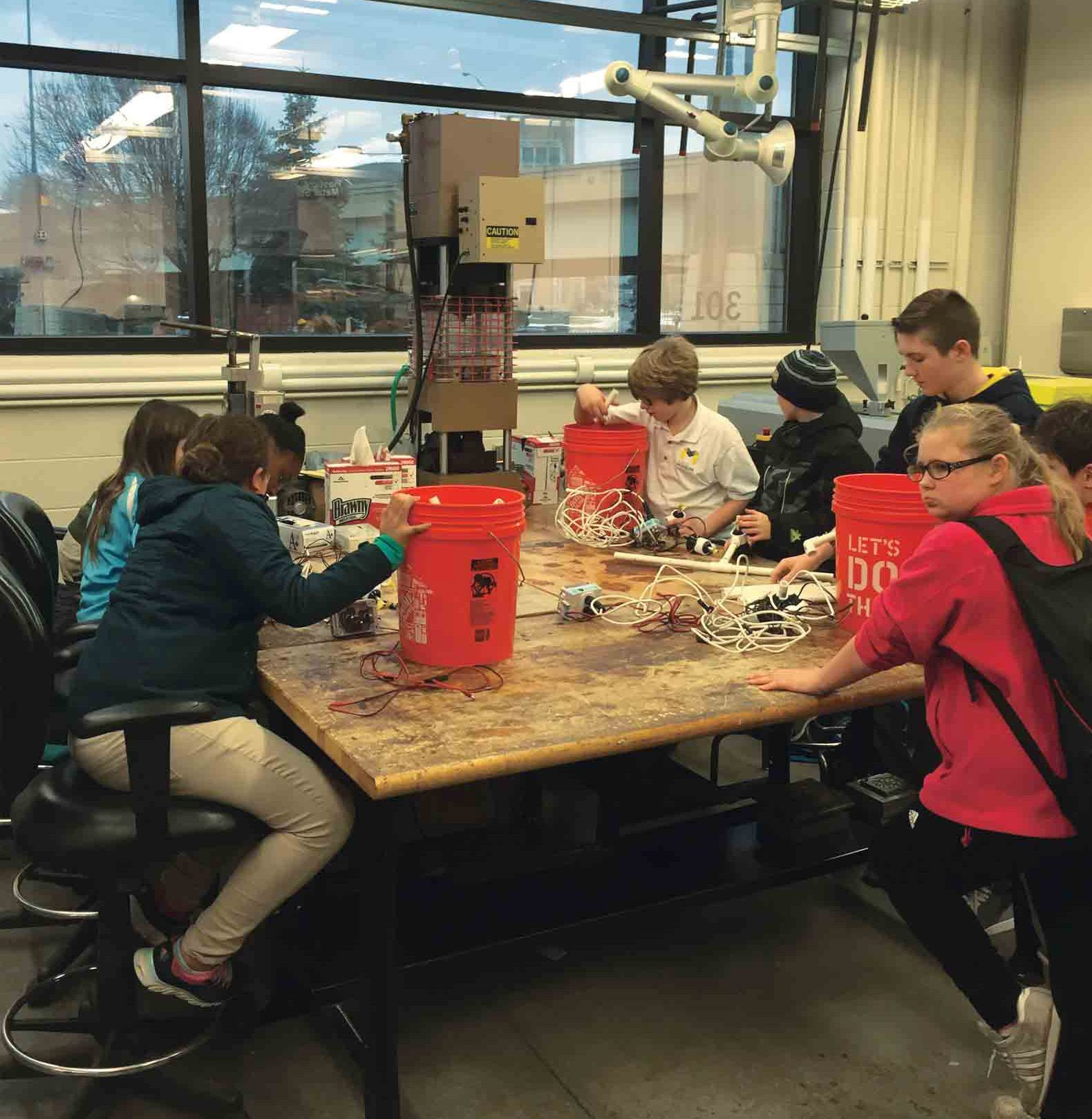 Hands-on learning occurs throughout the city for Museum School students. At Grand Valley State University, students take an underwater robotics class.