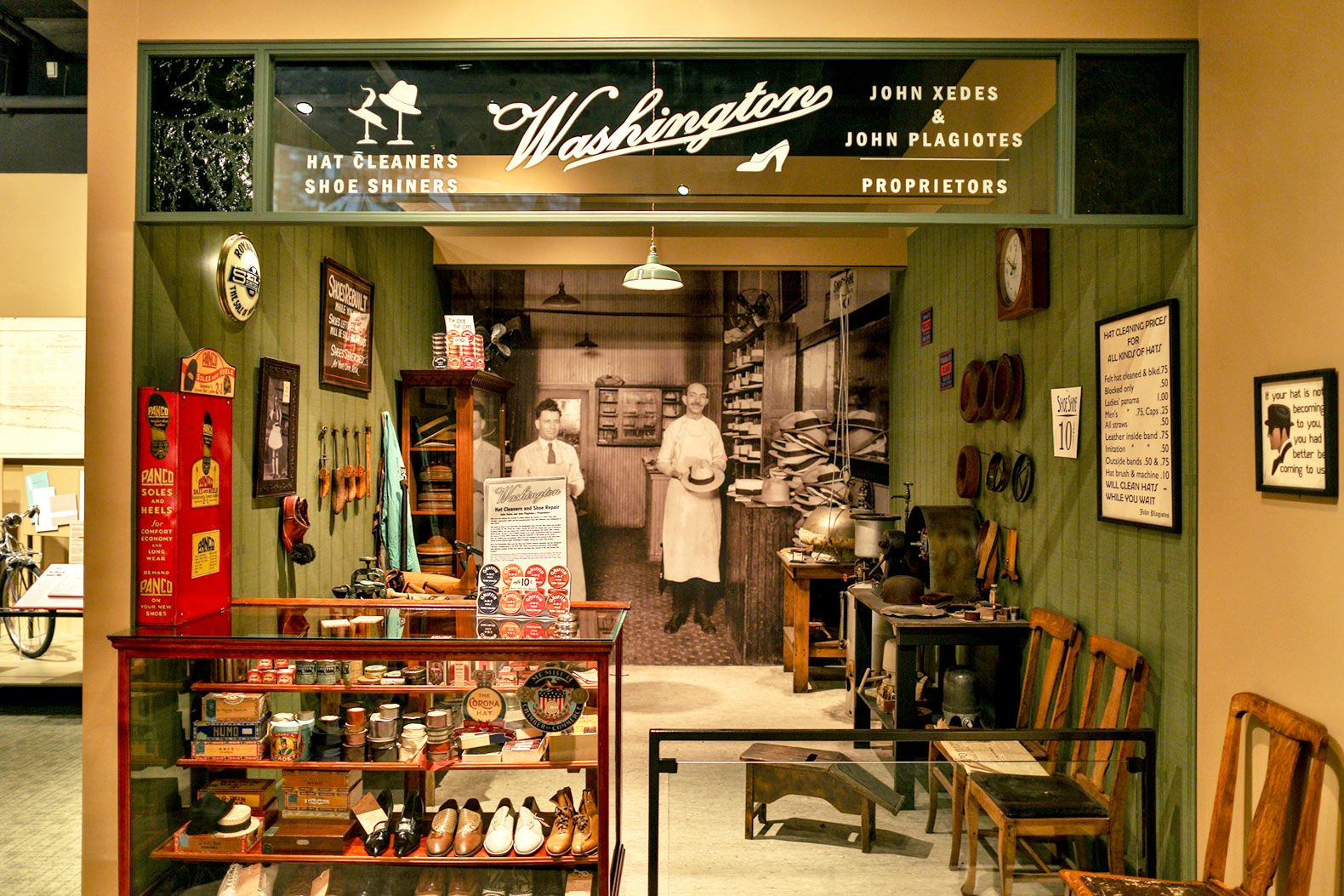 """A replica of a historic Grand Rapids storefront in the """"Newcomers"""" exhibit helps students understand the typical jobs and wages of three different immigrant groups who have settled in the area."""