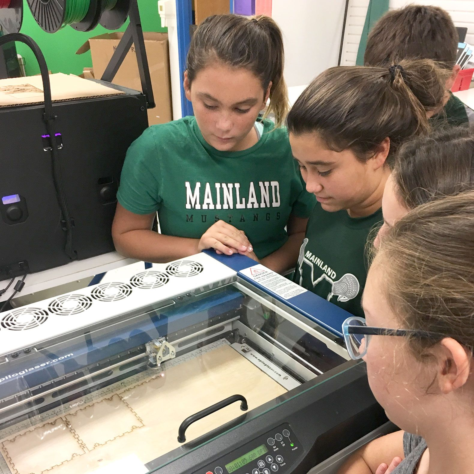Students use the laser engraver.