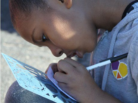 photo of a girl working with pen and ink