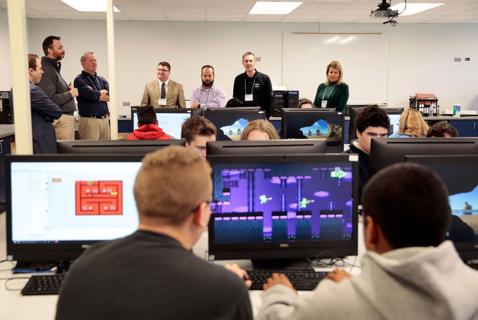 Visiting administrators and educators look in on a video game design class at West Leyden High School, part of the district's innovative efforts to integrate technology into its schools.