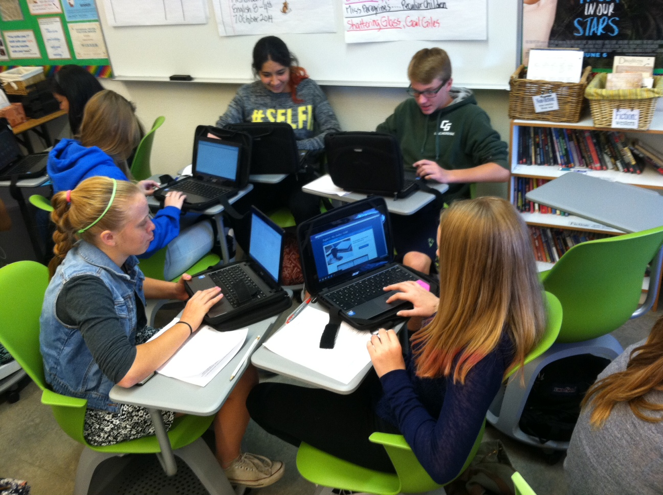 Students working together in rolling chairs