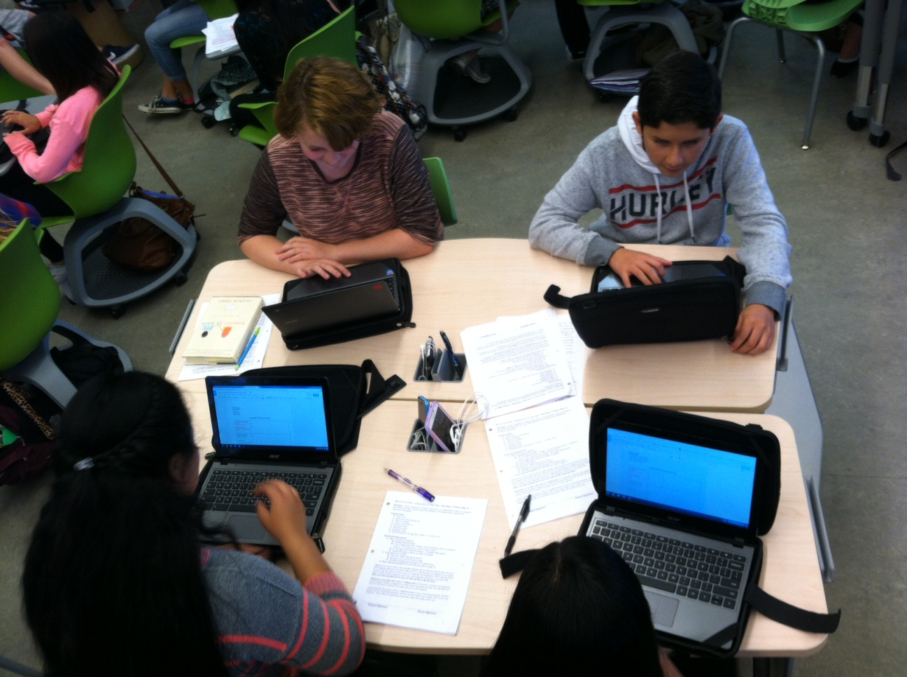 Students working together in stationary chairs
