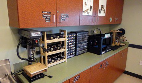 Counter top with drill presses, storage, etc. We will color-code our labels with pictures as we grow.