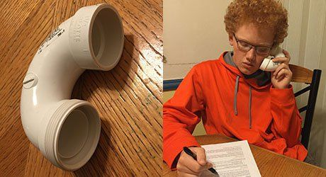 """Some students prefer using a """"whisper-phone,"""" an inexpensive curve of PVC pipe, to whisper and hear the reading with more privacy."""