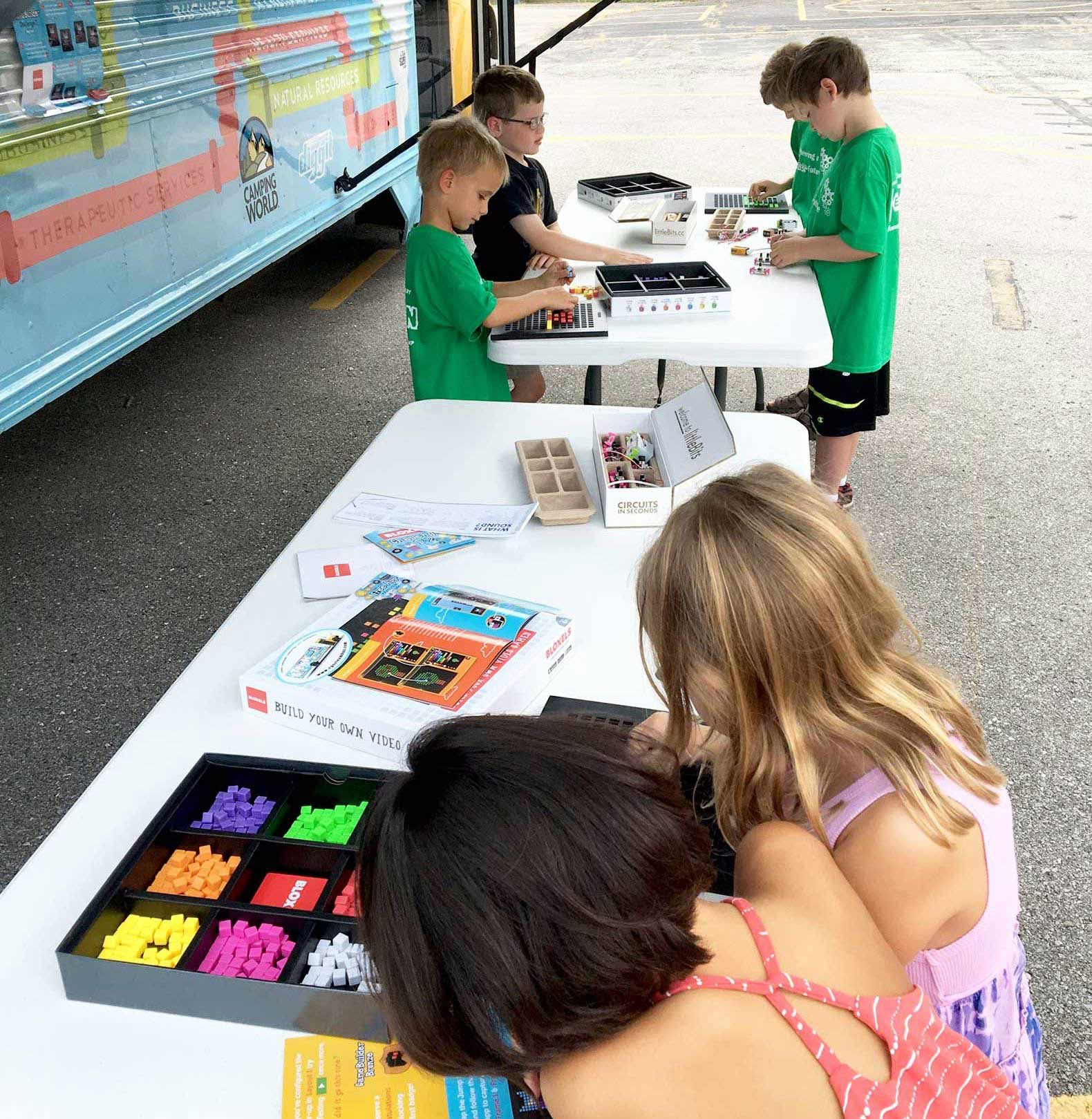 The bus gives students a chance to design video game characters using Bloxels (shown here). It also has a 3D printer and virtual reality glasses.