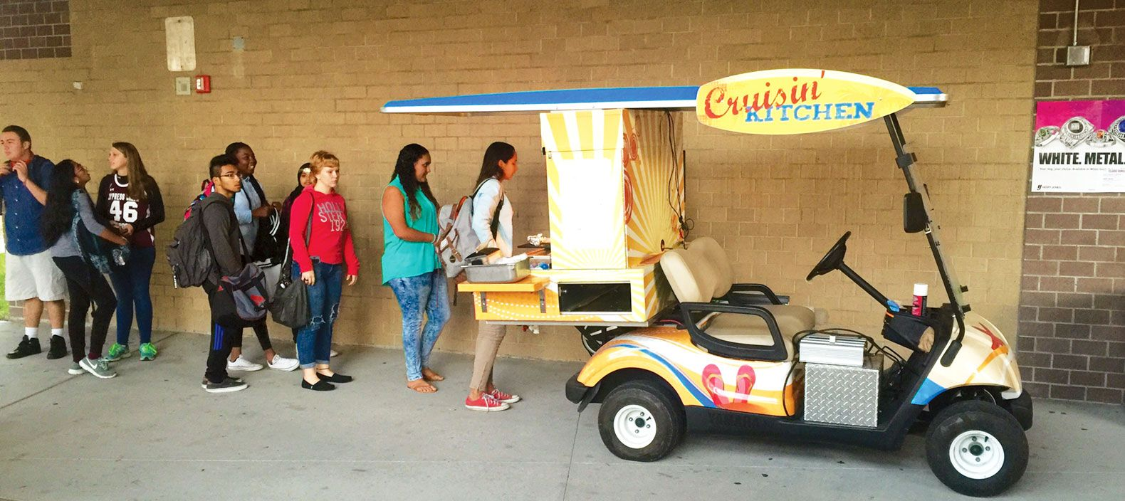 The district uses a golf cart to bring dinner to students at high-poverty schools who participate in after-school activities spread out over a large campus.