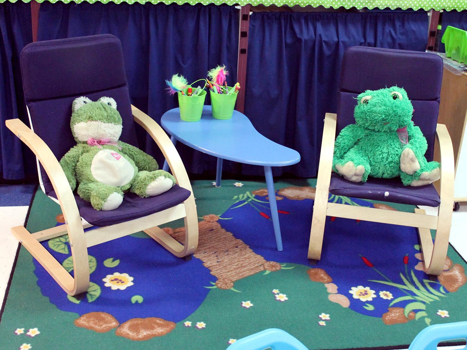 Moyers zoned off a reading area by placing two rocking chairs and a small table on a throw rug.