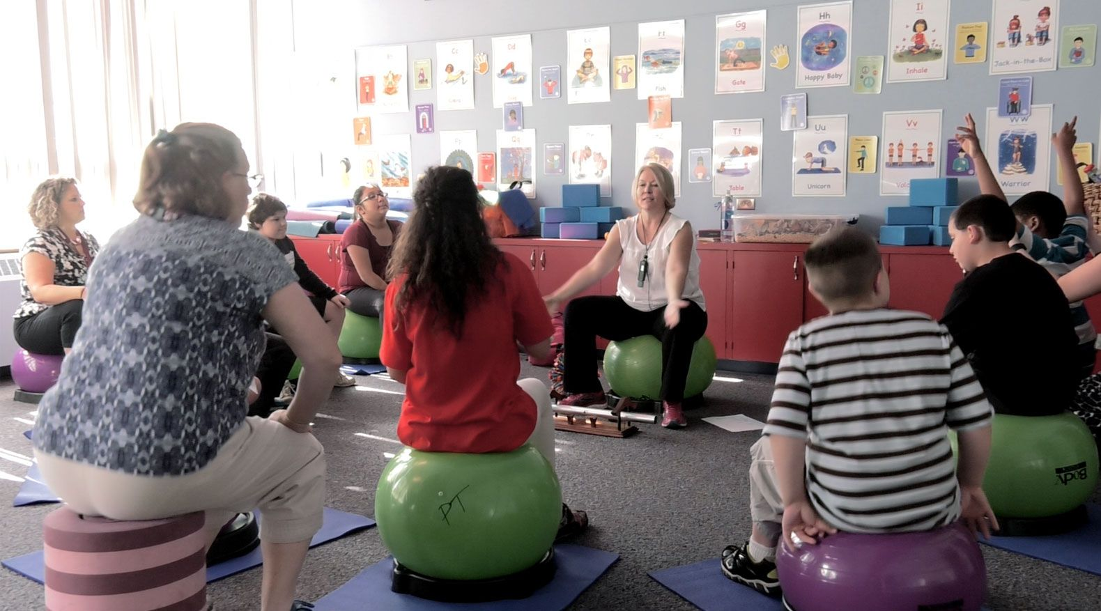 Students at Hanover Elementary begin their time in the sensory room bouncing in time to a metronome to build focus.