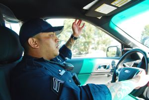 Officer Ron Singh in patrol car.
