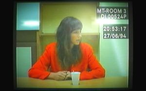A still of a woman being questioned from the video game, Her Story.