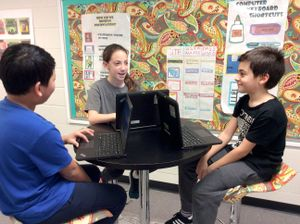 A group of students work on a project together at White Oak Elementary in Sugar Hill, Georgia.