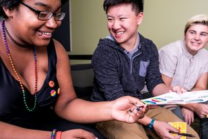 Students laugh while attending a youth summit for LGBTQ youth.
