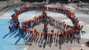 Elementary school students in Madison, Wisconsin, form a peace sign as part of a Unity Day celebration.