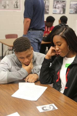A boy and girl discuss a project on Selma in Jessica Dickens' class.