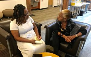 Teacher Shonda Dawson gets feedback from SNCC veteran Jennifer Lawson on her lesson.