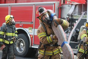 A student participates in a field experience with Lake Country Fire and Rescue.
