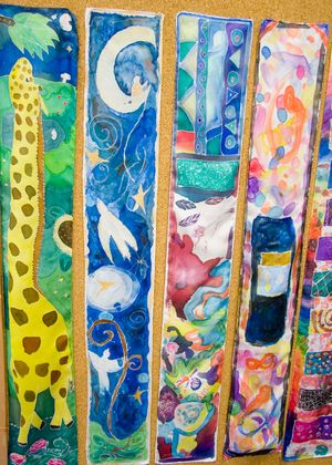Five long sheets of watercolor paper featuring assorted student art. The first painting is of a giraffe, the second is of doves on a night sky, and the remaining three are colorful abstract expressionist pieces.