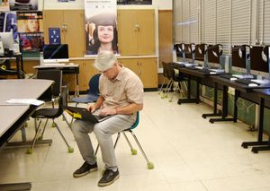 A teacher at Skyline High School looks at a student roster to target interventions.