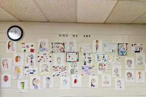A wall of identity portraits in Shana White's classroom.