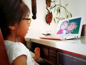 Young girl engaged in programming on a laptop