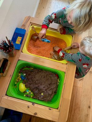 Children play with kinetic sand.