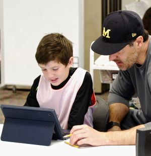 A boy and his father work on an assignment at Design39.