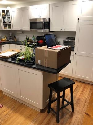John Thomas uses a box on his kitchen counter as a standing desk.