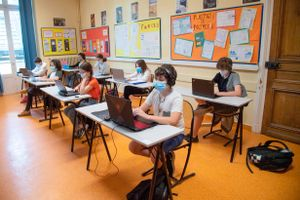 Teenagers wearing protective face masks are seen studying during a class day as middle school reoppened in France on June 2nd, 2020